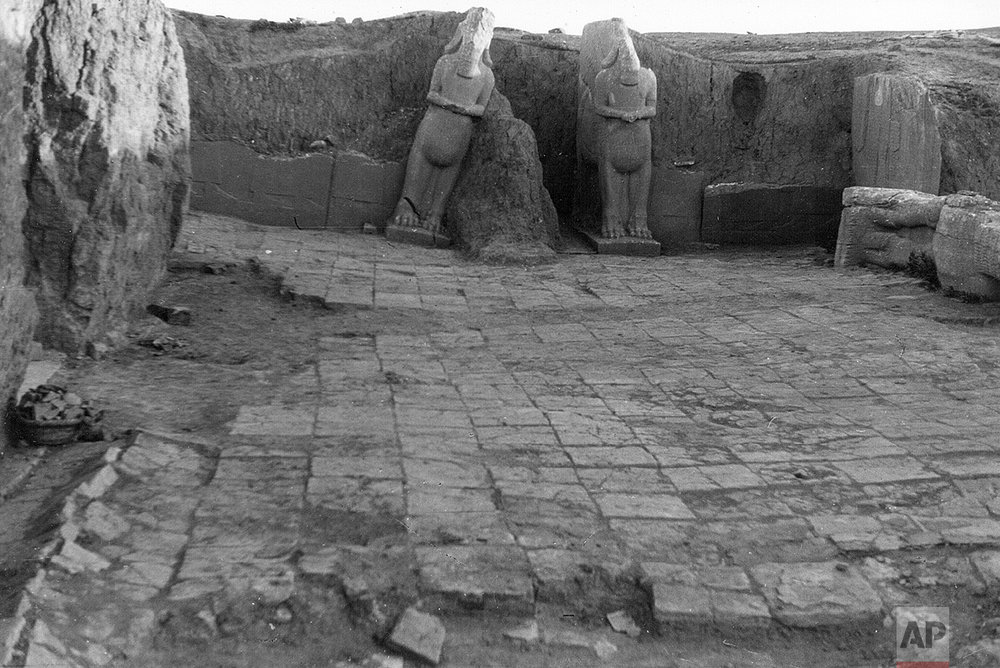 "This undated photo taken by mystery writer Agatha Christie shows statues of two Assyrian winged bull deities called lamassu stand at the entrance to Palace of Assurnasipal II at the ancient city of Nimrud in northern Iraq. Christie and her archaeologist husband also visited other sites in Iraq and neighboring Syria. Every winter, ""they disappeared into Iraq or Syria and returned in May or June. To her it was just as important as writing,"" says her grandson, Mathew Prichard. (Agatha Christie via AP)"