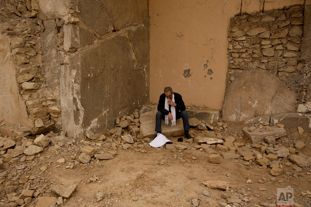 Sami Al-Khoja, a UNESCO official, pauses while participating in an assessment tour of the damage to the ancient site of Nimrud at the hands of Islamic State group militants in Iraq In this Wednesday, Dec. 14, 2016 photo. With the war against the militants still raging not far away, no one has been assigned to guard the site, much less catalogue what is left after IS blew up its ancient palaces and carved apart and smashed its elaborate reliefs. (AP Photo/Maya Alleruzzo)