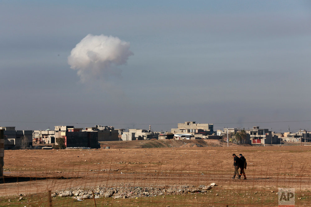 A plume of smoke rises as Iraqi elite counterterrorism forces fight Islamic State militants to regain control of the Quds neighborhood of Mosul, Iraq, on Friday, Dec. 30, 2016. Iraqi government forces launched a large-scale offensive in mid-October to retake Mosul, the last major urban center held by the extremist group in Iraq. The offensive, however, had stalled about two months later because of the presence inside Mosul of some one million civilians, stiff IS resistance and the lack of urban warfare experience among some Iraqi units. (AP Photo/ Khalid Mohammed)