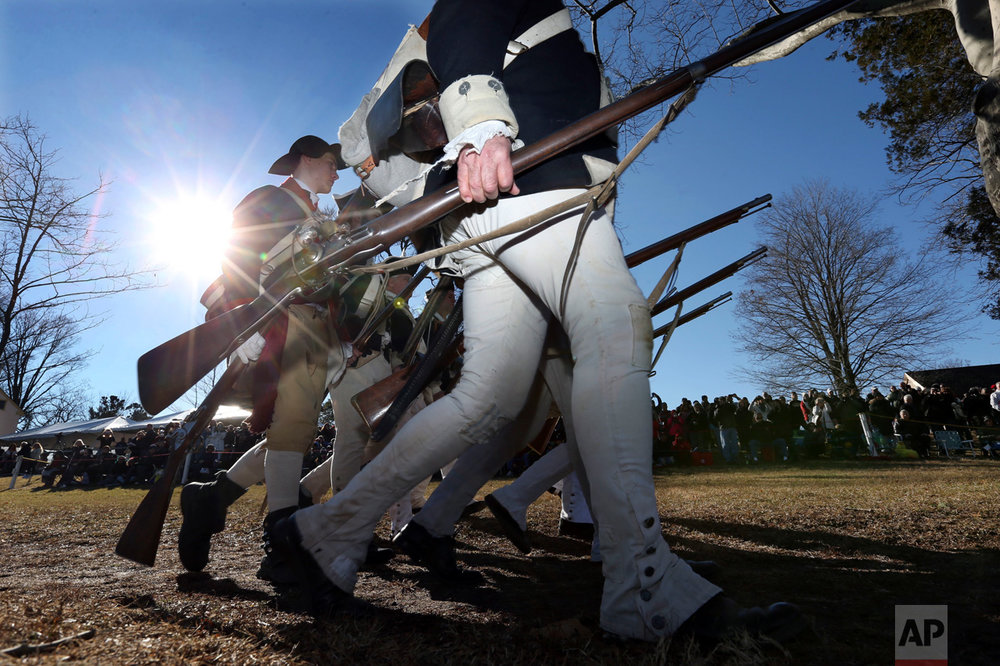 Participants march as they prepare to re-enact Gen. George Washington's Christmas 1776 crossing of the Delaware River, the trek that turned the tide of the Revolutionary War, in Washington Crossing, Pa., on Sunday, Dec. 25, 2016. (AP Photo/Mel Evans)