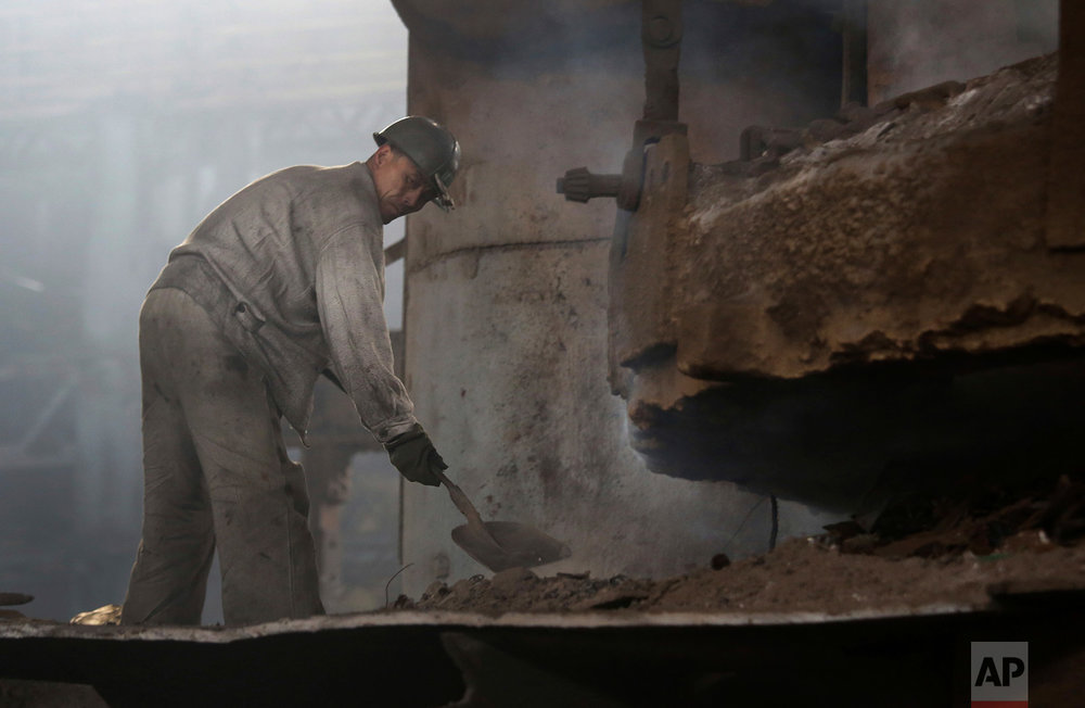 In this Saturday, Jan. 7, 2017 photo, a North Korean man works at the Chollima Steel Complex in Nampo, North Korea. North Korean officials and factory managers are scrambling to answer a call from leader Kim Jong Un for an all-out, nationwide effort to build up the country's economy in 2017. The sprawling Chollima complex south of Pyongyang, the capital, is a focal point of North Korea's effort to expand the economy and lift the nation's standard of living. One of seven North Korean steel works, Chollima has more than 8,000 workers and is among the North's showcase enterprises. (AP Photo/Wong Maye-E)