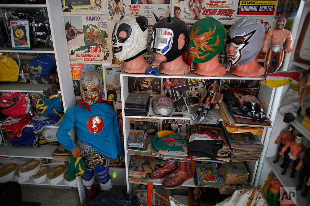 "In this Jan. 11, 2017 photo, Mexican ""lucha libre"" wrestling masks and other paraphernalia are displayed in the Lucha Libre room of the Mexico Antique Toy Museum in Mexico City. The museum is having to struggle following a congressional decision to stop allocating cultural funds for the collection. The museum has had to cut staff by half and most of its cultural events and workshops have been suspended, says the son, who hopes to raise money for the museum through a Kickstarter campaign.(AP Photo/Dario Lopez-Mills)"