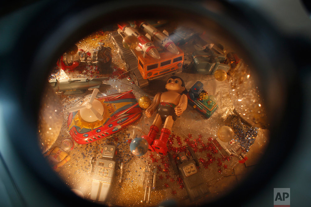In this Jan.11, 2017 photo, toys displayed inside a steel box are seen through a magnifying glass at the Mexico Antique Toy Museum in Mexico City. The Mexico Antique Toy Museum is a four story building filled with toys and objects that bring back childhood memories to the visitors that enter this unique monument to hoarding behavior. (AP Photo/Dario Lopez-Mills)