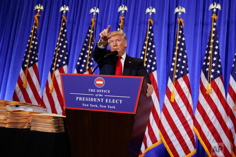 President-elect Donald Trump calls on a reporter during a news conference in the lobby of Trump Tower in New York, Wednesday, Jan. 11, 2017. This was his first news conference as president-elect. (AP Photo/Evan Vucci)