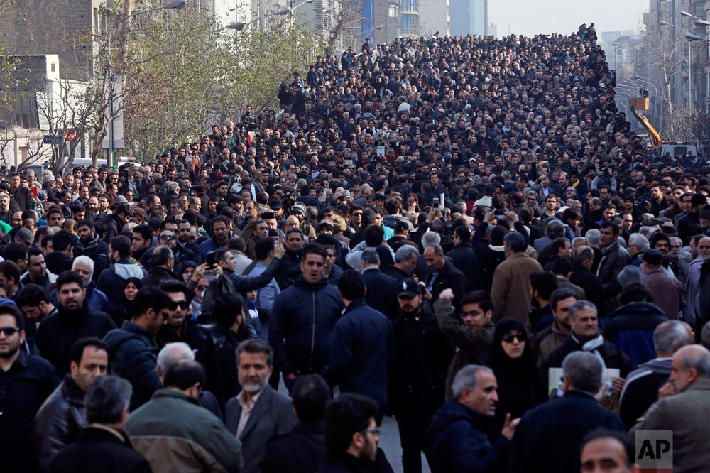 Mourners attend the funeral of former Iranian President Akbar Hashemi Rafsanjani, in Tehran, Iran, Tuesday, Jan. 10, 2017. Hundreds of thousands of mourners flooded the streets of Tehran, beating their chests and wailing in grief for Rafsanjani, who died at the age of 82. (AP Photo/Vahid Salemi)