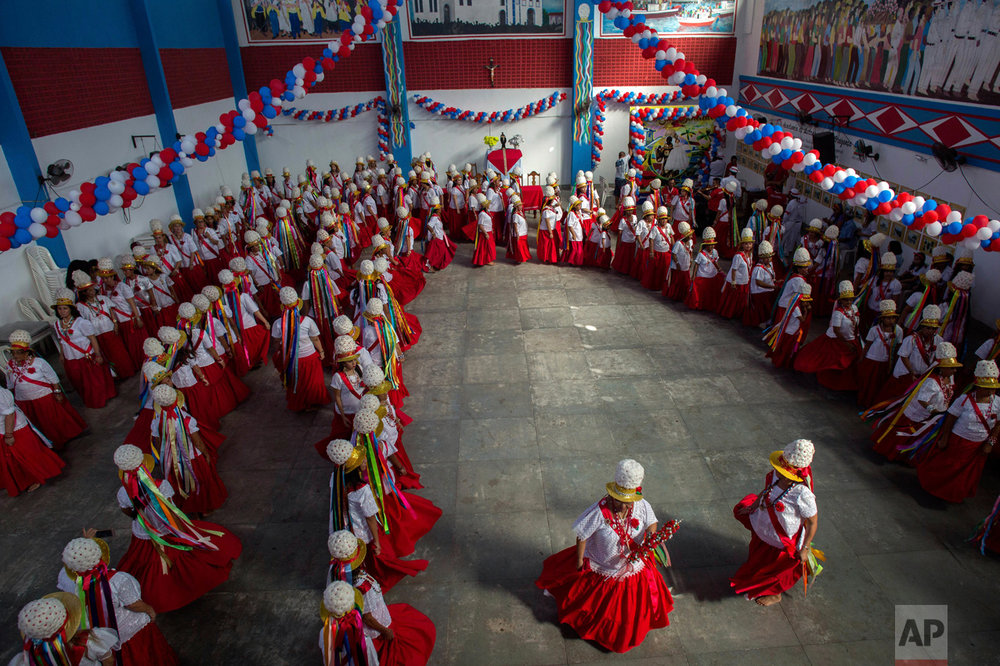 This Dec. 26, 2016 photo shows women performing the Retumbao dance during Marujada religious celebrations in honor of St. Benedict in the fishing town of Braganca, Brazil. Locals say the annual celebration, which started in 1798, is a way to show appreciation and make good on promises for miracles received. (AP Photo/Eraldo Peres)
