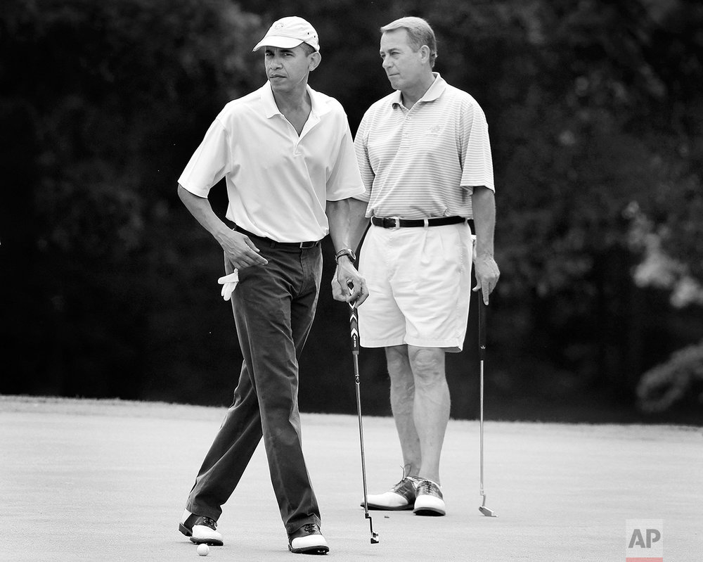 President Barack Obama and House Speaker John Boehner, R-Ohio, are on the first hole as they play golf at Andrews Air Force Base, Md.,  Saturday, June 18, 2011. (AP Photo/Charles Dharapak)