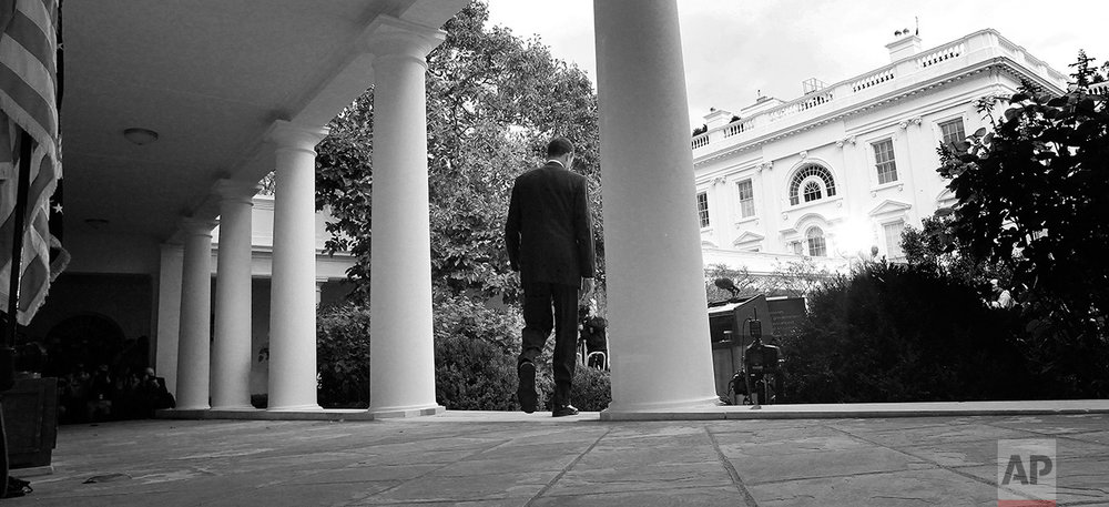President Barack Obama walks to the Rose Garden at the White House in Washington to make a statement to reporters, Thursday, Oct. 20, 2011.  (AP Photo/Charles Dharapak)