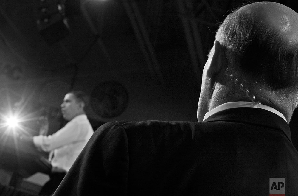 A U.S. Secret Service agent stands watch as President Barack Obama speaks about health care reform, at Arcadia University in Glenside, Pa., Monday, March 8, 2010. (AP Photo/Charles Dharapak)