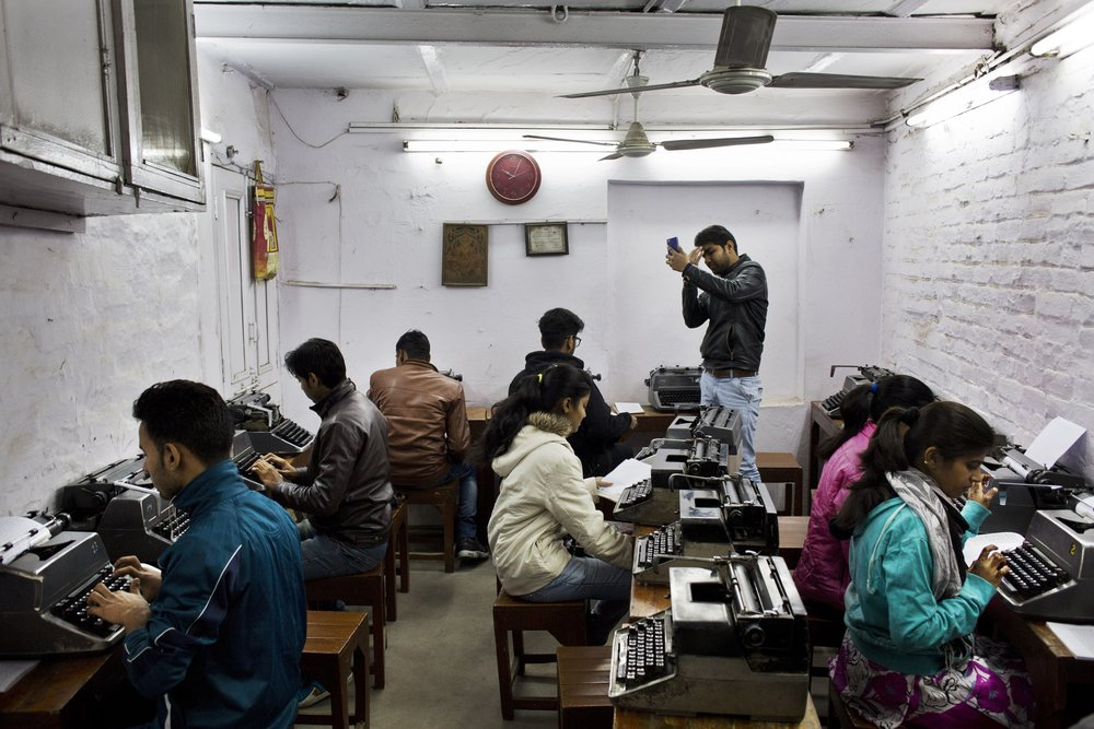 In this Jan. 17, 2017 photo, Indian students practice at a local typewriting school in New Delhi, India. Twenty years ago, there were hundreds of little typing schools in New Delhi, crowded with university students, aspiring clerks and young women hoping for jobs as secretaries. There are still typing schools that, at least occasionally, are jammed with students. But even in this country, one of the last places in the world where the typewriter remains a part of everyday life, the end is, finally, coming. (AP Photo/Bernat Armangue)