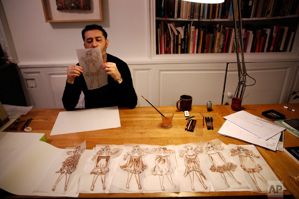 French fashion designer Franck Sorbier draws his Spring-Summer 2017 Haute Couture fashion collection, in Paris, Thursday, Oct. 27, 2016. (AP Photo/Christophe Ena)