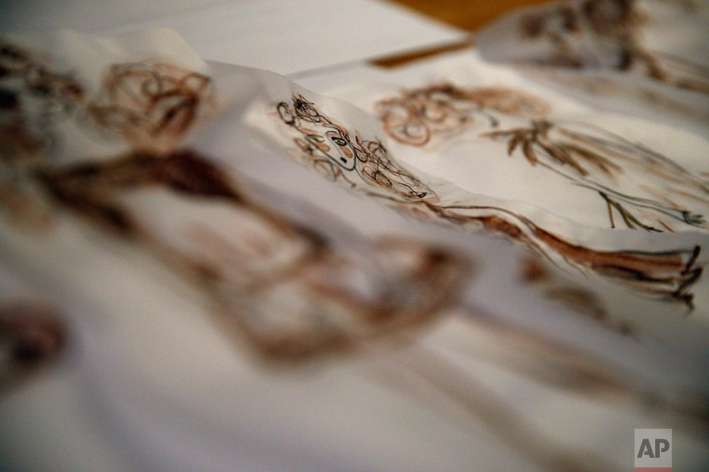 Drawings of French fashion designer Franck Sorbier for his Spring-Summer 2017 Haute Couture fashion collection are pictured, in Paris, Thursday, Oct. 27, 2016. From the earliest ink sketches to the final touches on this season's stunning floral gowns, Frank Sorbier is one of the last Parisian couturiers to do it all himself. (AP Photo/Christophe Ena)