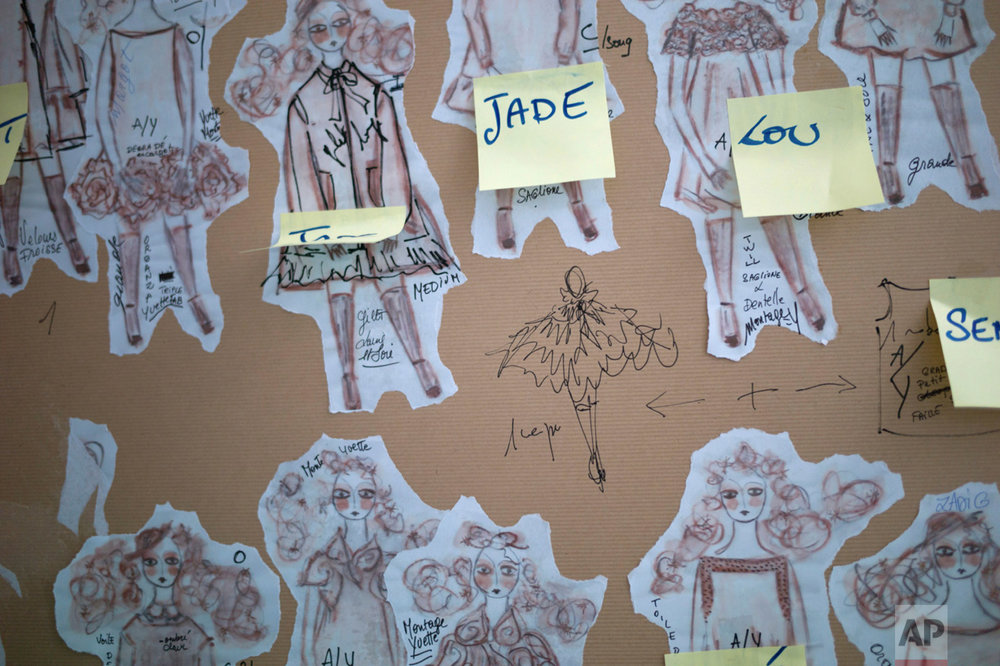 Drawings of dresses are displayed on a board at the Franck Sorbier's office, during the manufacturing of his Spring-Summer 2017 Haute Couture fashion collection, in Paris, Friday, Dec. 23, 2016. (AP Photo/Thibault Camus)
