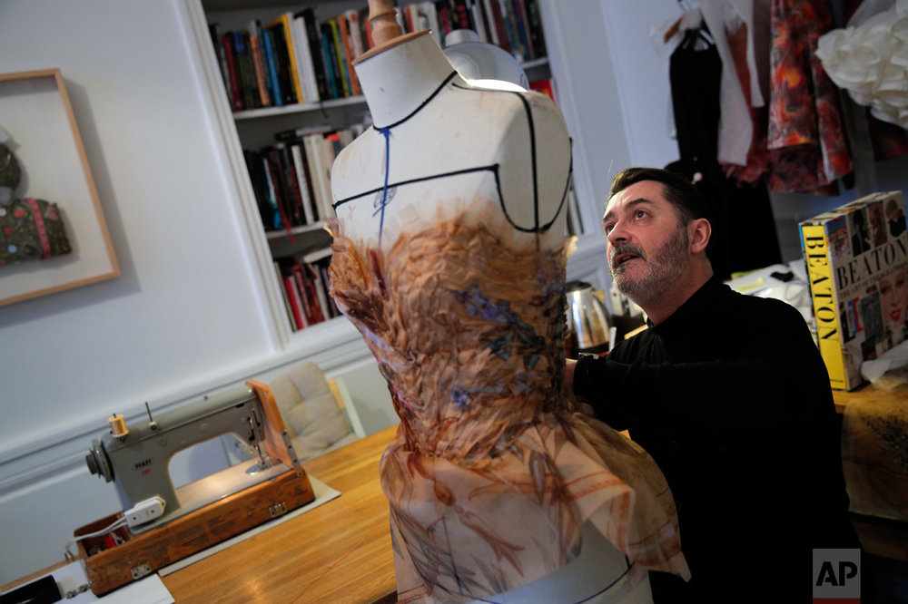 French fashion designer Franck Sorbier works on a dress for his Spring-Summer 2017 Haute Couture fashion collection, in Paris, Wednesday, Dec. 28, 2016. For the diaphanous spring-summer haute couture collection he showed in Paris this week, Sorbier burned the midnight oil with his small atelier team starting in October, as Associated Press photographers followed his creative process from conception to catwalk. (AP Photo/Christophe Ena)
