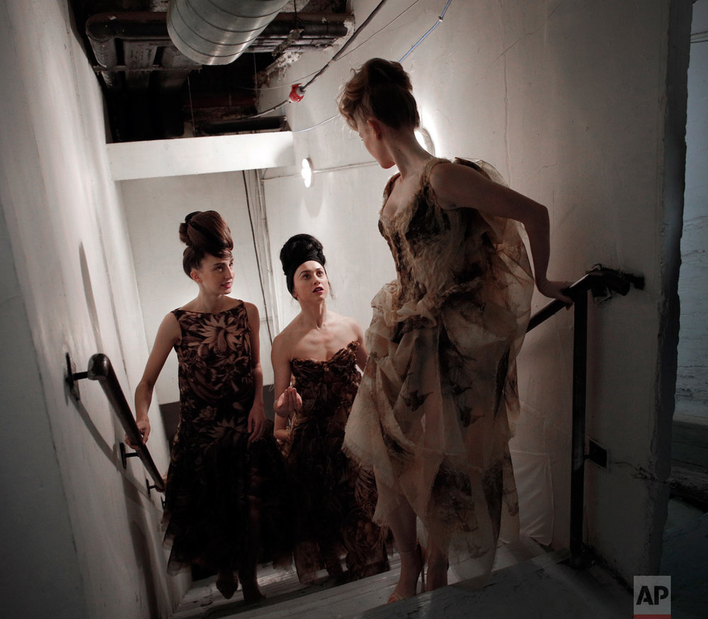 Models arrive backstage after Franck Sorbier's Spring-Summer 2017 Haute Couture fashion collection presented in Paris, Wednesday, Jan. 25, 2017. (AP Photo/Christophe Ena)
