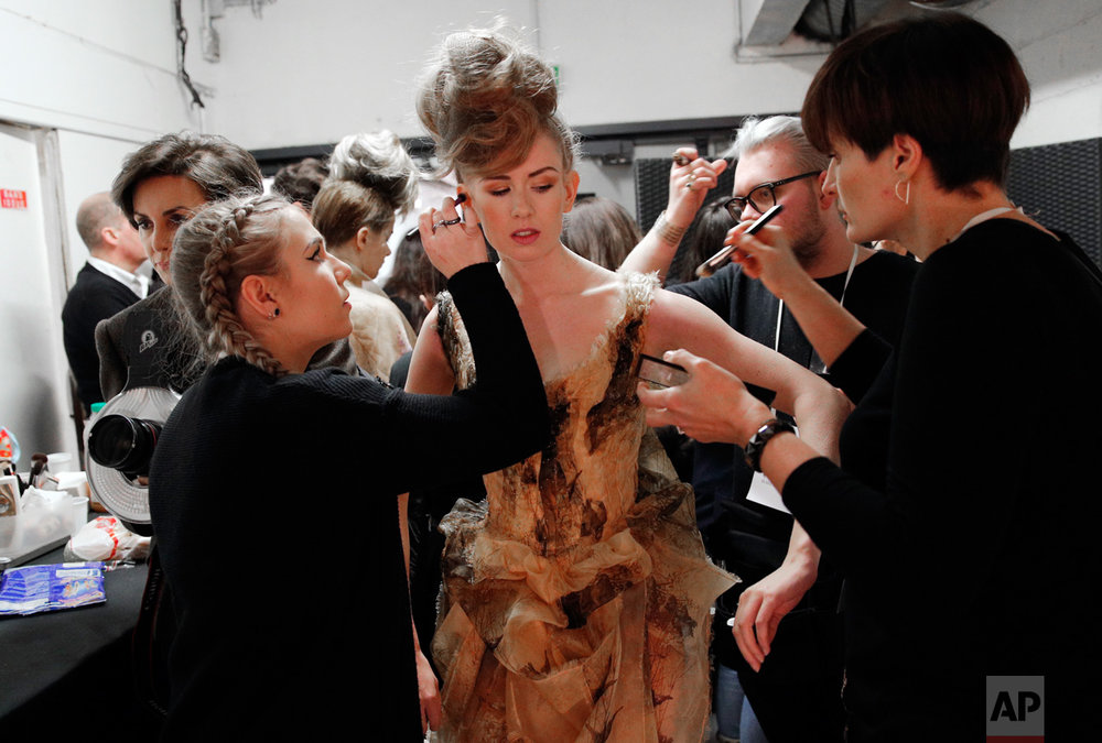 A model is made up backstage prior to Franck Sorbier's Spring-Summer 2017 Haute Couture fashion collection, in Paris, Wednesday, Jan. 25, 2017. (AP Photo/Christophe Ena)