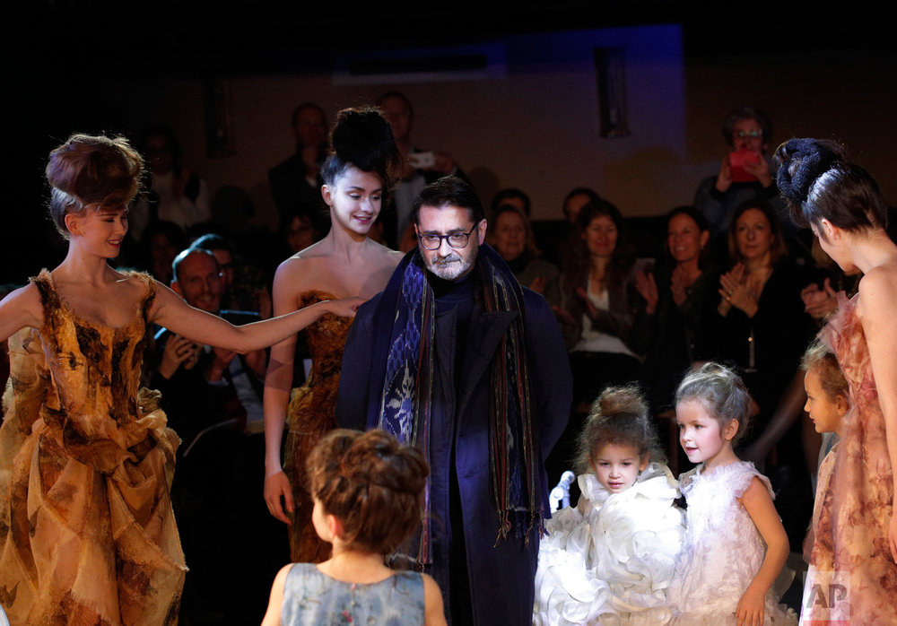 French fashion designer Franck Sorbier poses after his Spring-Summer 2017 Haute Couture fashion collection presented in Paris, Wednesday, Jan. 25, 2017. (AP Photo/Christophe Ena)