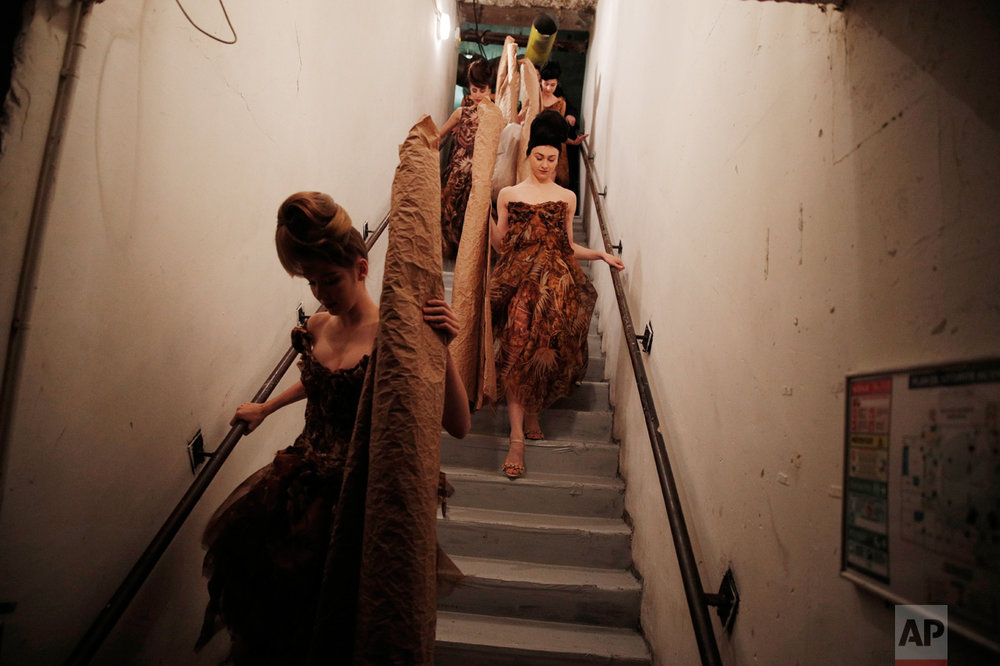 Models leave the backstage to present the Franck Sorbier's Spring-Summer 2017 Haute Couture fashion collection, in Paris, Wednesday, Jan. 25, 2017. (AP Photo/Christophe Ena)