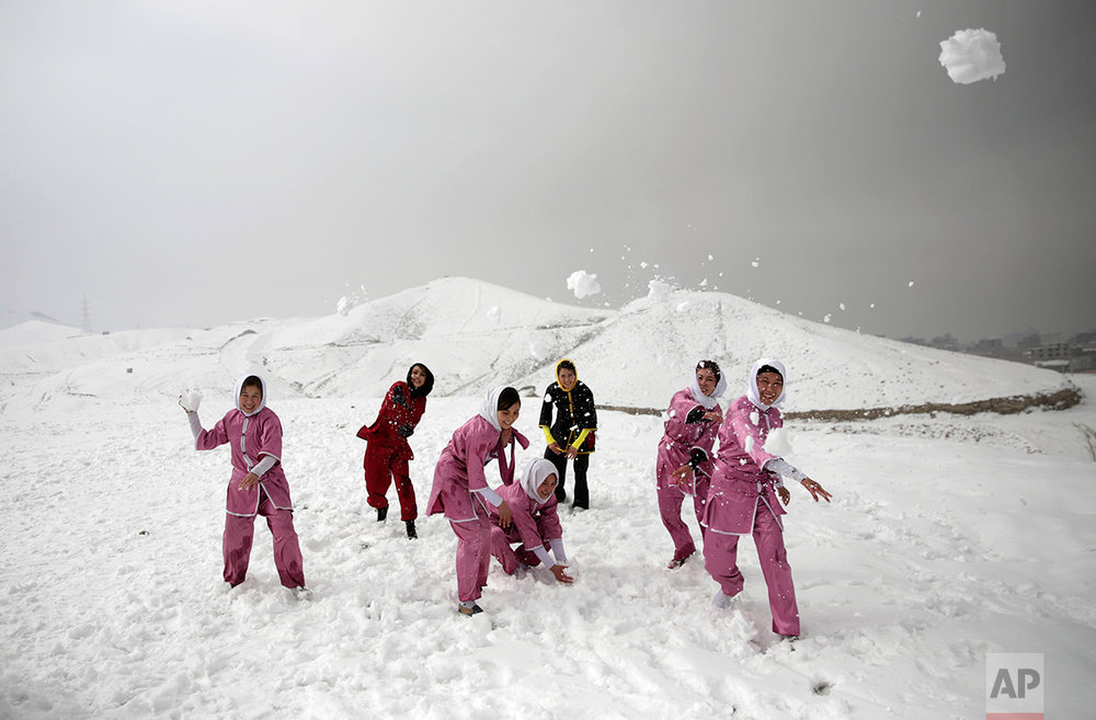Shaolin martial arts students and their trainer have a snowball fight after their training session in Kabul, Afghanistan, Tuesday, Jan. 25, 2017. The ten ethnic Hazara women and girls practice the martial arts of Shaolin on a hilltop in the west of Kabul. They are preparing for the day that Afghanistan can send its women's team to the Shaolin world championship in China. (AP Photos/Massoud Hossaini)