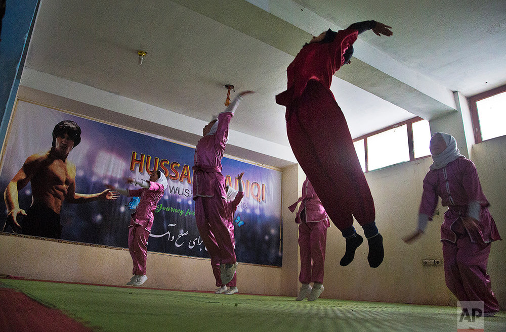 Shaolin martial arts students practice at their club in Kabul, Afghanistan, Tuesday, Jan. 25, 2017. When they aren't training on the snow covered hills that surround Kabul, the students train in the grungy, dark club financed by a young cinema actor. (AP Photos/Massoud Hossaini)