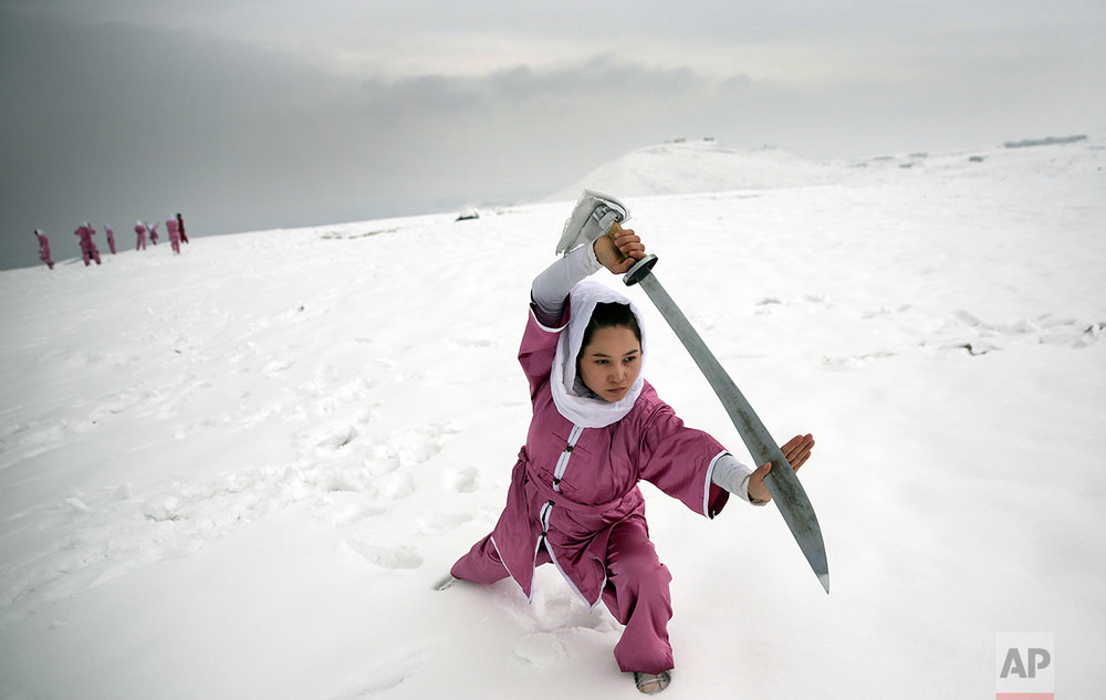 A Shaolin martial arts student practices on a hilltop in Kabul, Afghanistan, Tuesday, Jan. 25, 2017. The students are preparing for the day that Afghanistan can send its women's team to the Shaolin world championship in China. (AP Photos/Massoud Hossaini)