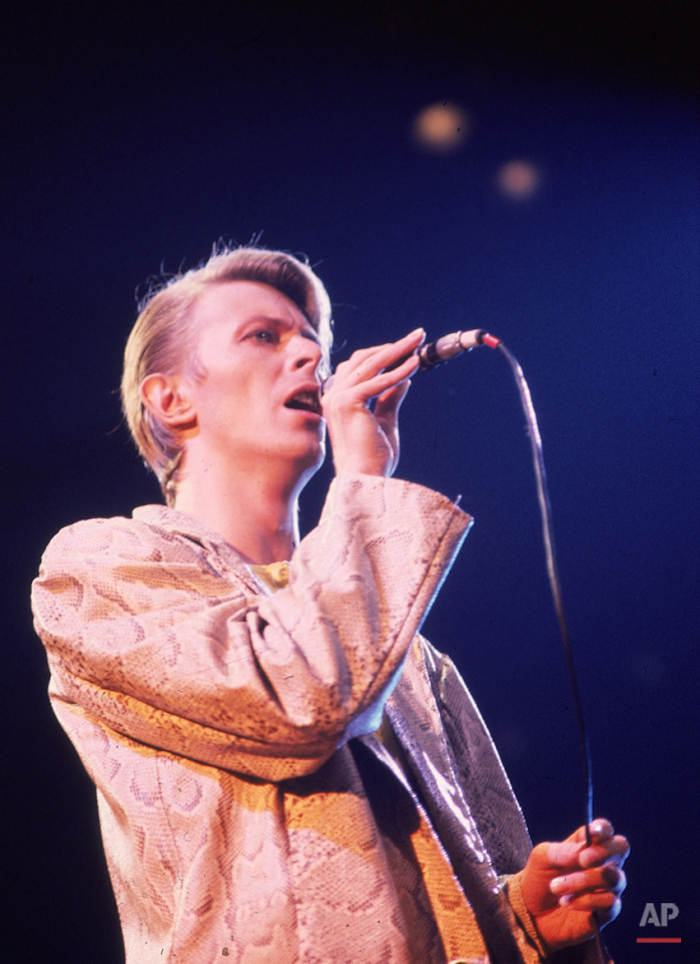 British rock singer, David Bowie, shown performing at a New York concert in May 1978. (AP Photo/Brian Killigrew)