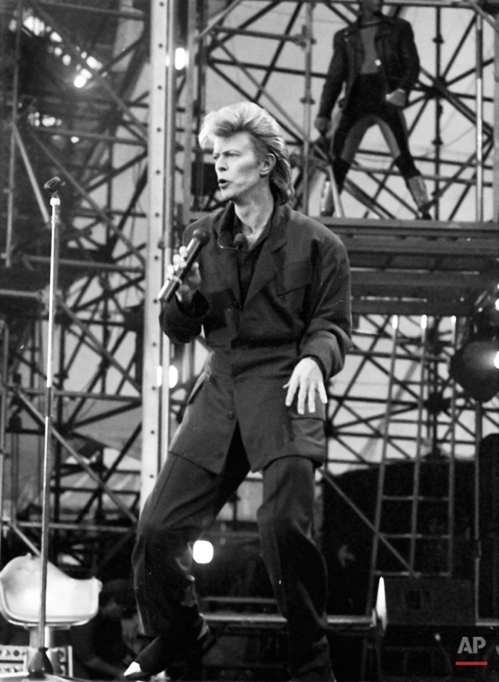 David Bowie performs on stage during his concert at Wembley Stadium on Saturday, June 20, 1987. (AP Photo)