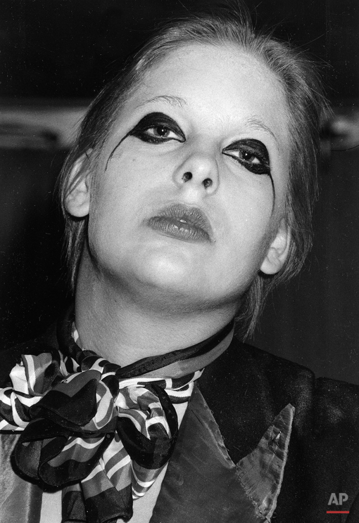 A fan of glitter-rock singing star David Bowie wears makeup at Bowie's weekend concert at New York's Radio City Music Hall, Nov. 3, 1974. (AP Photo/Suzanne Vlamis)