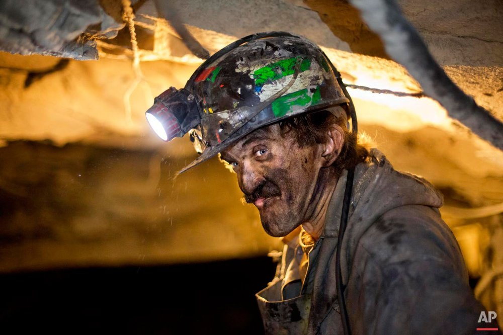 Dennis Ferrell, a coal miner of 15 years, watches over conveyer belts carrying coal out of the Sally Ann 1 mine Tuesday, Oct. 6, 2015, in Welch, W.Va. Now employment is falling further because the world is trying to turn away from coal in hopes of protecting the environment and human health. Coal is by far the biggest source of carbon dioxide and airborne pollutants among fuels used to make electricity. (AP Photo/David Goldman)