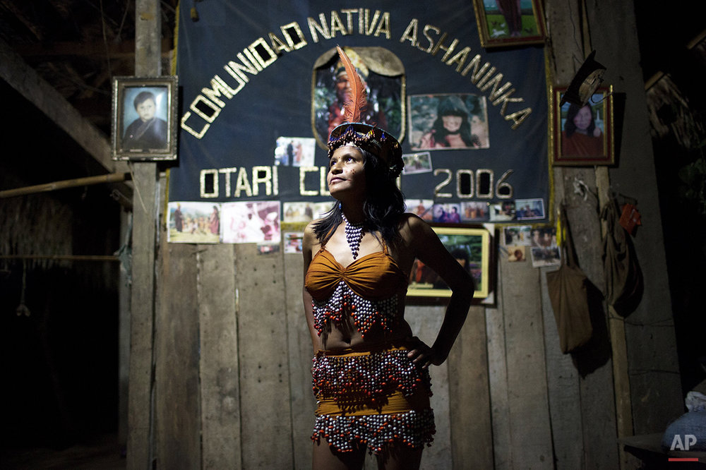 In this June 23, 2015 photo, Beysi Anaya, 17, strikes a pose after winning the Ashaninka Indian beauty contest, during the annual festivities marking the founding of the community in Otari Nativo, Pichari, Peru. Anaya was pleased with her win, but said she wants to study agronomy to help improve the cacao, coffee and achiote crops grown by her community. (AP Photo/Rodrigo Abd)