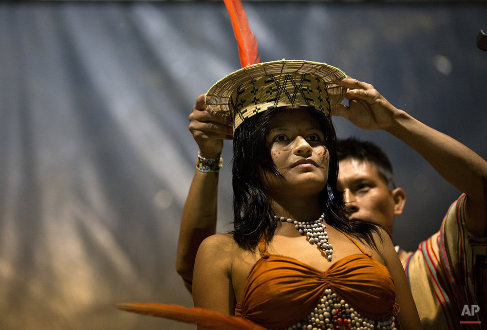 "In this June 23, 2015 photo, Beysi Anaya, 17, representing the Sampantuari village, is crowned the beauty contest winner during the annual festivities marking the founding of the Ashaninka community of Otari Nativo, Pichari, Peru. ""The little red dots are my happiness,"" said Anaya, who traveled three hours by car from her native valley community to compete in the beauty contest. (AP Photo/Rodrigo Abd)"