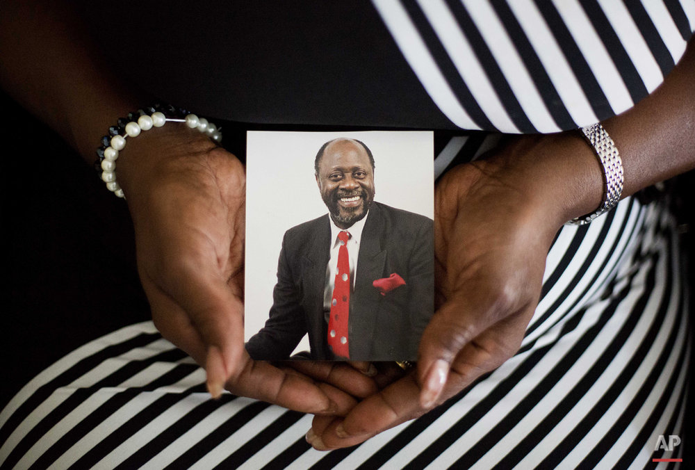 Annie Simmons, wife of 24 years of Daniel Simmons Sr., one of the nine people killed in Wednesday's shooting at Emanuel AME Church, holds a photo of her husband at her home Friday, June 19, 2015, in North Charleston, S.C. (AP Photo/David Goldman)