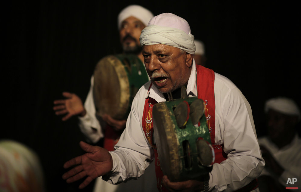 In this Thursday, April 30, 2015 photo, musicians play tambourines during a performance in collaboration with the Al-Tannoura Egyptian Heritage Dance Troupe at the ?El Dammah Theatre in Cairo, Egypt.  (AP Photo/Amr Nabil)