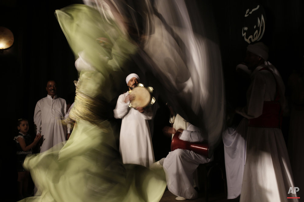 In this Thursday, April 30, 2015 photo, a whirling dervish spins during a performance in collaboration with the Al-Tannoura Egyptian Heritage Dance Troupe at the El Dammah Theatre in Cairo, Egypt.  (AP Photo/Amr Nabil)