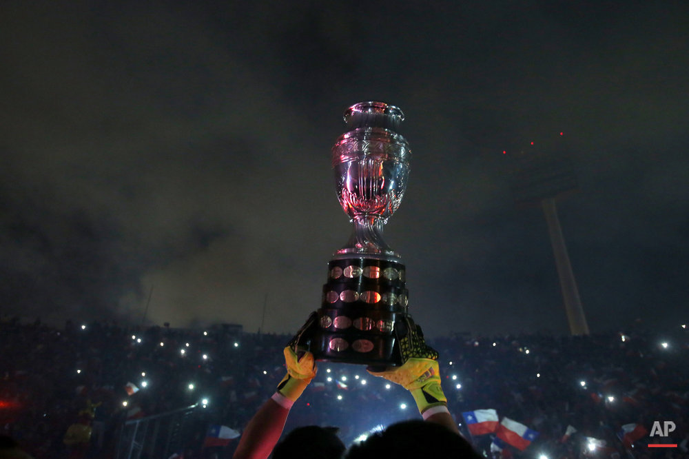 Chile's goalkeeper Claudio Bravo lifts the Copa America trophy after defeating Argentina in the final soccer match at the National Stadium in Santiago, Chile, Saturday, July 4, 2015. Chile became Copa America champions for the first time after defeating Argentina in a penalty shootout. (AP Photo/Luis Hidalgo)