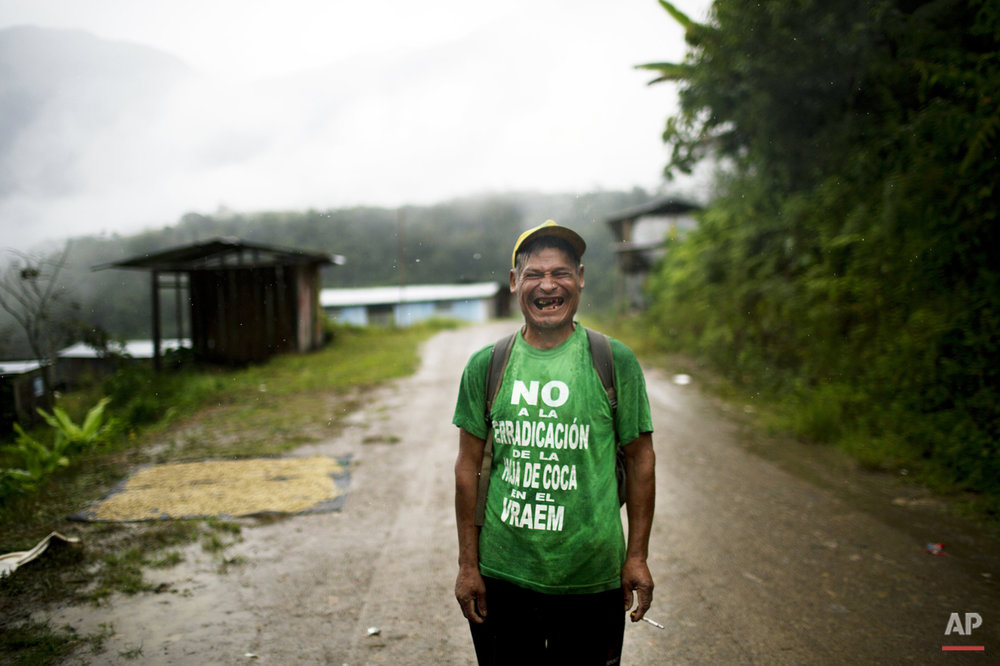 "In this March 15, 2015 photo, Fortunato Farfan, laughs while posing for the picture in La Mar, province of Ayacucho, Peru. Fortunato's is wearing a T-shirt with a phrase that reads in Spanish: ""No to coca eradication in the Vraem"".  Not a single fully paved road rises out of the Apurimac, Ene and Mantauro river valley (VRAEM), from which cocaine also departs via small plane to neighboring Bolivia. (AP Photo/Rodrigo Abd)"