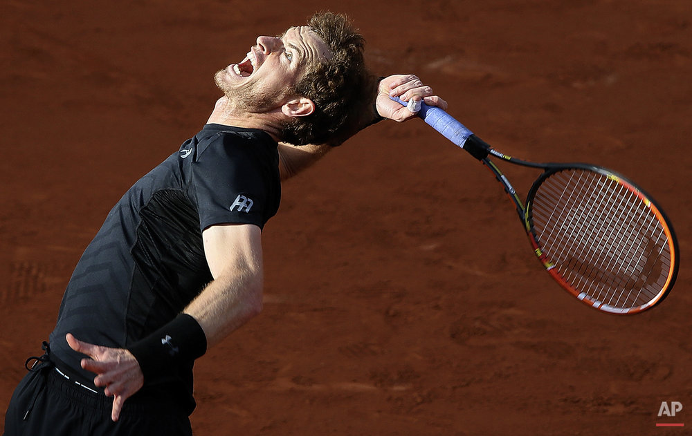 Britain's Andy Murray serves the ball to Argentina's Facundo Arguello during their first round match of the French Open tennis tournament at the Roland Garros stadium, Monday, May 25, 2015 in Paris. Murray won 6-3, 6-3, 6-1. (AP Photo/David Vincent)