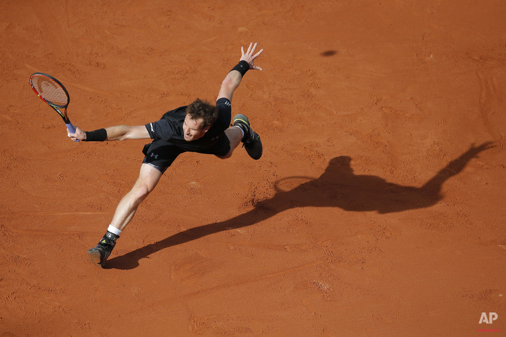 Britain's Andy Murray returns in the first round match of the French Open tennis tournament against Argentina's Facundo Arguello at the Roland Garros stadium, in Paris, France, Monday, May 25, 2015. (AP Photo/Christophe Ena)
