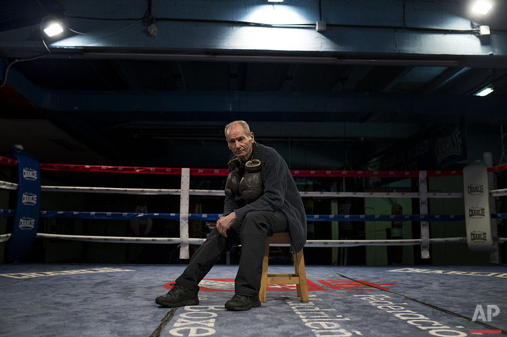 In this Thursday, May 19, 2016 photo, boxing coach Manolo del Rio poses for a photograph inside the ring at El Rayo boxing gym in Madrid. At 84, Manolo del Rio is something of a legend in Spanish boxing circles, having spent more than 65 years training some of the country's best fighters and pledging to keep on going until he drops. (AP Photo/Francisco Seco)