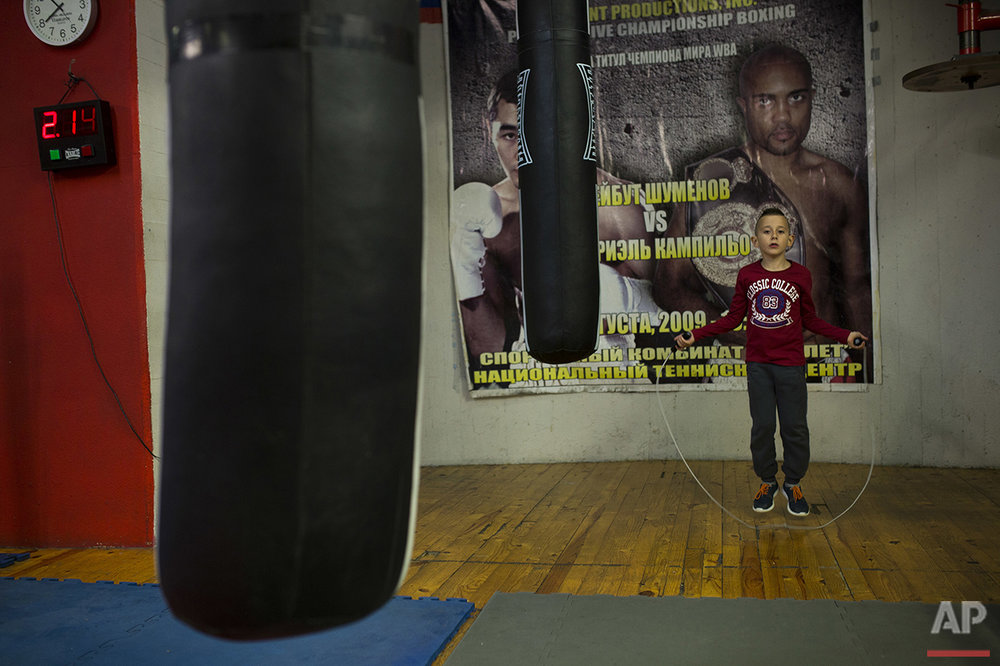 In this Friday, April 22, 2016 photo, young boxer Mario Andres Ciobanu, 8, works out during a training session at El Rayo boxing gym in Madrid. (AP Photo/Francisco Seco)