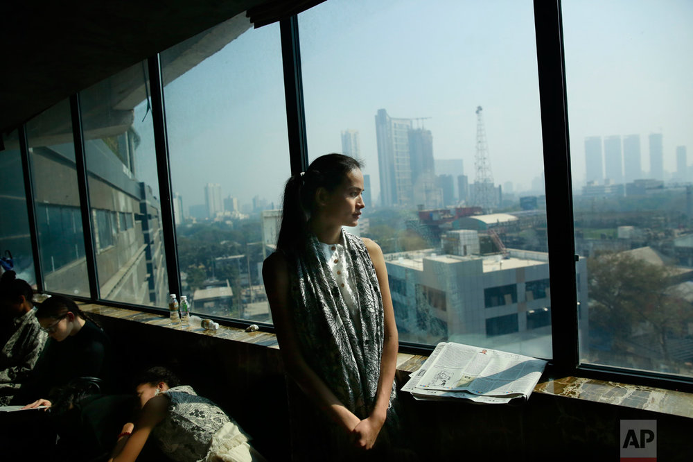 In this  Jan 30, 2017 photo, Anjali Lama, a transgender model from Nepal, looks out of a window of a hotel during a trial event for Lakme Fashion week in Mumbai, India. Growing up as the fifth son in a poor farming family in rural Nepal the dream to be a fashion model came late in life. First came a long, painful struggle to accept that he felt deeply female. It was a chance encounter with a group of transgender women that turned Lama's life around by putting her in touch with the Blue Diamond Society, an advocacy group for Nepal's LGBT community. In 2005, she came out to her friends and family as a transgender woman. (AP Photo/Rafiq Maqbool)