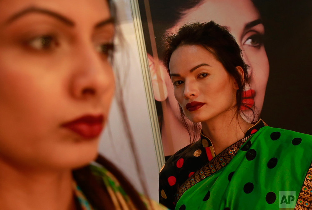 In this Feb. 2, 2017 photo, Anjali Lama, a transgender model from Nepal, stands backstage at the Lakme Fashion week in Mumbai, India. Growing up as the fifth son in a poor farming family in rural Nepal the dream to be a fashion model came late in life. First came a long, painful struggle to accept that he felt deeply female. It was a chance encounter with a group of transgender women that turned Lama's life around by putting her in touch with the Blue Diamond Society, an advocacy group for Nepal's LGBT community. In 2005, she came out to her friends and family as a transgender woman. (AP Photo/Rafiq Maqbool)