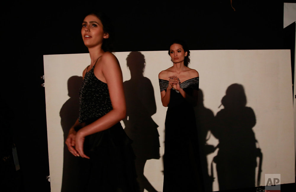 In this Feb. 1, 2017 photo, Anjali Lama, right, a transgender model from Nepal, waits backstage for her turn to walk the ramp during Lakme Fashion week in Mumbai, India. To model for Lakme Fashion Week, one of the highlights of India's fashion calendar, is Lama's big moment. It's a dream that was years in the making and often seemed far beyond the reach of Lama now being touted as the first transgender woman to model for the high fashion event sponsored by a top Indian cosmetics brand. (AP Photo/Rafiq Maqbool)