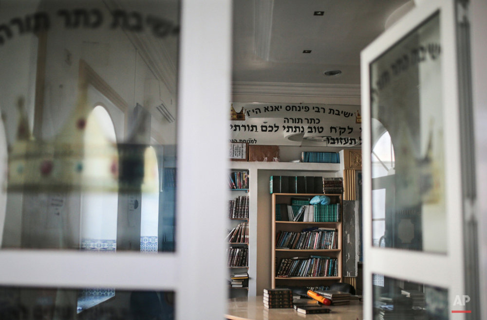 In this Friday, Oct. 30, 2015 photo, Jewish holy books are seen at a library at Hara Kbira, the main Jewish neighborhood on the Island of Djerba, southern Tunisia. The Jewish community in the resort island of Djerba traces its roots all the way back to Babylonian exile of 586 B.C., and is one of the few communities of its kind to have survived the turmoil around the creation of Israel, when more than 800,000 Jews across the Arab world either emigrated or were driven from their homes. (AP Photo/Mosa'ab Elshamy)