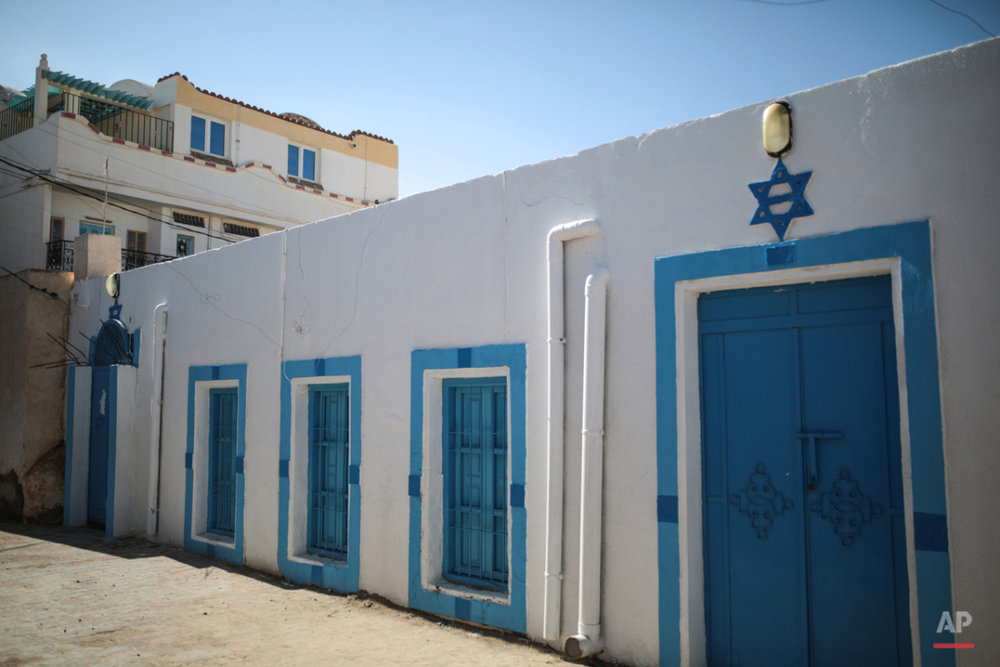 In this Friday, Oct. 30, 2015 photo, a Star of David is seen outside the Synagogue of the Kohanim of Djirt, at Hara Kbira, the main Jewish neighborhood on the Island of Djerba, southern Tunisia. Tunisiaís Jewish population has dwindled from 100,000 in 1956, when the country won independence from France, to less than 1,500, mainly as a result of emigration to France and Israel. But unlike in much of the rest of the Arab world, Tunisian Jews have seen little direct persecution and have only rarely been targeted by extremists. (AP Photo/Mosa'ab Elshamy)