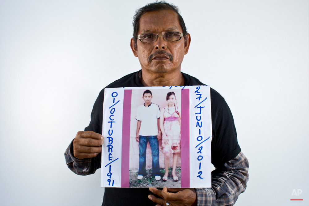 In this May 26, 2015 photo, Jaime Velazquez Betancourt holds up a photo of his son, Jorge Alberto Garcia Valverde, left, and his daughter, Adilene Garcia Valverde, in Iguala, Mexico. On June 29, 2012, Velazquez's son and daughter were just minutes from their home in Cocula returning from dinner with a friend. Witnesses said that between 9:30 and 10 p.m. two Iguala police vehicles stopped them. They took 19-year-old Adilene and 21-year-old Jorge Alberto, along with their friend. None of them have been seen since. The Iguala police told Velazquez they had no record of the arrests and did not have patrol cars in that area that night. (AP Photo/Dario Lopez-Mills)