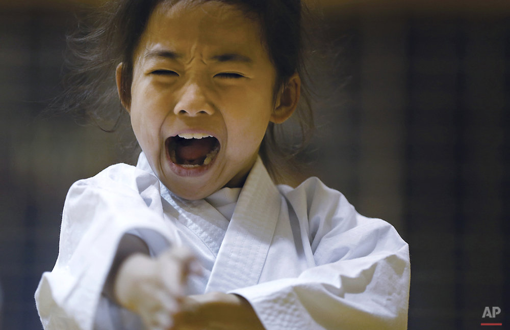 "In this Nov. 18, 2015 photo, 9-year-old Mahiro Takano, three-time Japan karate champion in her age group practices in Nagaoka, Niigata prefecture, north of Tokyo. Mahiro stars in singer Sia's latest music video ""Alive,"" the just-released single from the singer's upcoming album.(AP Photo/ Eugene Hoshiko)"