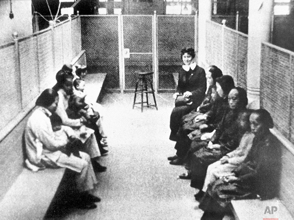 In this late 1920s photo, a group of Chinese and Japanese women and children wait to be processed, held in a wire mesh enclosure at the Angel Island Internment barracks in San Francisco Bay. The Angel Island Immigration Station processed one million immigrants from 1910 to 1940, mostly from China and Japan. (AP Photo)