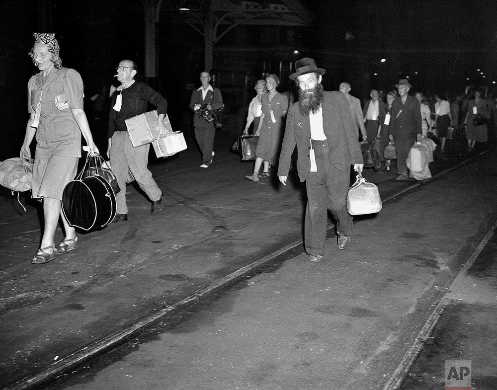 In this Aug. 4, 1944 photo, civilian refugees from occupied Europe arrive at Hoboken, N.J., during World War II. The refugees, who will be given sanctuary for the duration of the war, will go to Fort Ontario, Oswego, N.Y., where an emergency relief shelter was established. Jewish refugees from Europe were blocked during and after World War II _ first because of fears that they might be German sympathizers, then because of fears that they were Communists. (AP Photo)