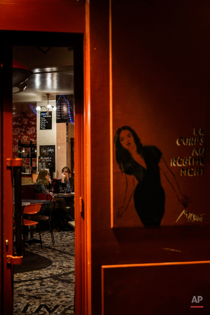In this Nov. 17, 2015 picture people enjoy dinner at 'Chez Gladines' close to one of the spots of Friday's attacks in Paris. Parisians are returning to cafes, bars and restaurants, determined that the Nov. 13 attacks won't alter the city's way of life. President Francois Hollande has told his compatriots that 'life must resumed in full,' asking: 'What would our country be without its cafes?'(AP Photo/Daniel Ochoa de Olza)